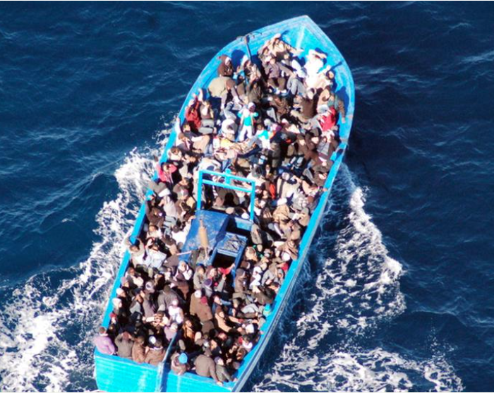 Refugees on a boat on the open sea in the year 2015