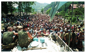 Dutch UN peacekeepers watch Bosnian Muslims who have fled Srebrenica arrive at Potocari village, some 5km away. Photograph: Associated Press