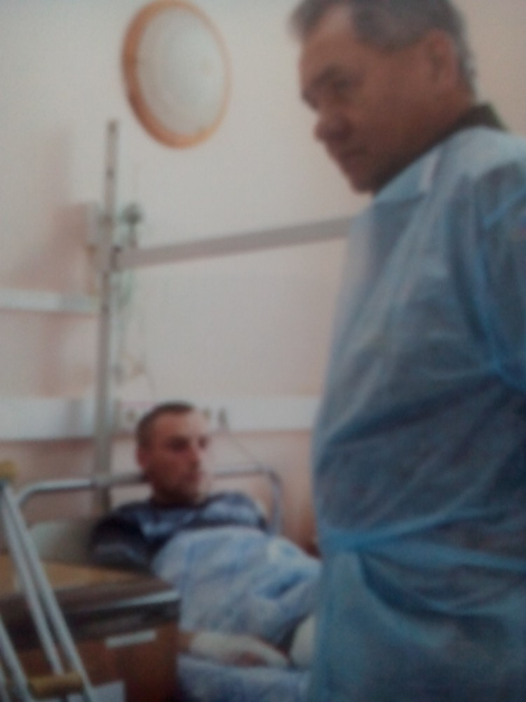 "The photo shows Usov lying on a hospital bed. To Ivan Badanin's question ""What did the minister Sergey Shoigu say to you?"" Usov replies the minister had wished him to get well and go back to the ranks soon and gifted him a watch."