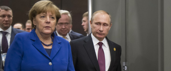 German Chancellor Angela Merkel, left, and Russian President Vladimir Putin enter a hall for their talks during the G-20 Summit in Antalya, Turkey, Monday, Nov. 16, 2015. (AP Photo/Alexander Zemlianichenko, Pool)