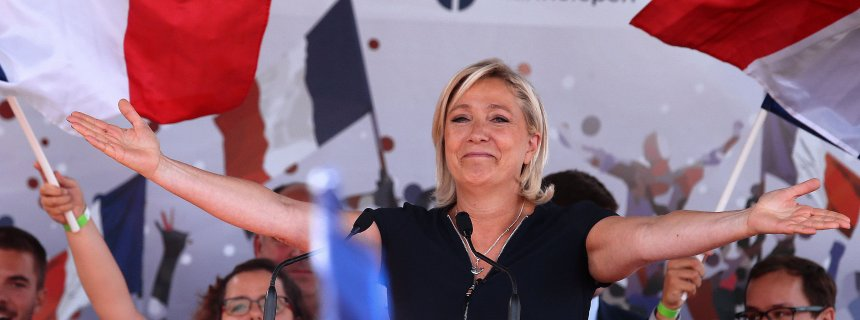 French far-right party Front National (FN) President and member of the European Parliament, Marine Le Pen gestures as she delivers a speech on September 3, 2016 during a FN political rally in Brachay, northeastern France.