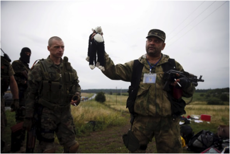 Pro Russian terrorists savaging the crash site of flight #MH17, which was shot down by a Russian BUK missile in July 2014 (source: Bellingcat and Bild Newspaper) https://www.bellingcat.com/?s=mh17
